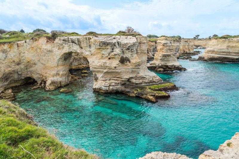 Torre Sant'Andrea: Scopriamo la Spiaggia dei Faraglioni